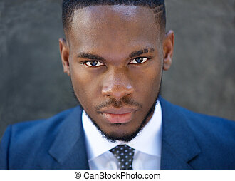Close up handsome young business man in suit