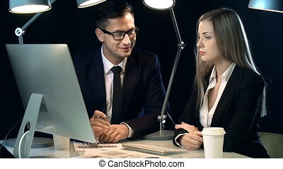Business Dealings - Close up of two colleagues discussing...
