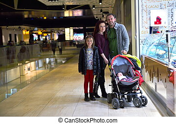 family in shopping mall