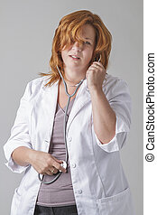 Belly ache - forty something woman doctor with red hair,...