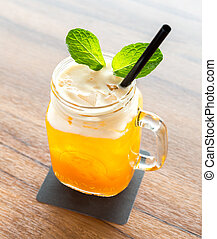 Ice Passionfruit tea - glass of Ice Passionfruit tea with...