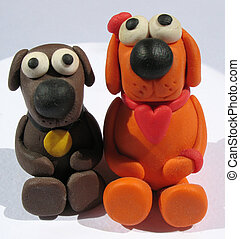 A plasticine toys. Handmade. The little funny dogs on the...