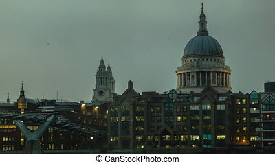 St Pauls and Millenium Bridge in cloudy weather, close up.