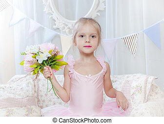 Little girl stand with flowers