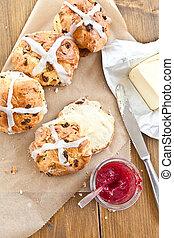 Hot cross buns with butter and jam - Fresh hot cross buns...