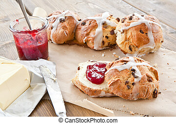 Hot cross buns with butter and jam - Fresh hot cross buns...