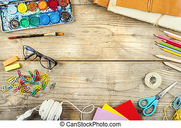 Desk of an artist with lots of stationery objects. Studio...
