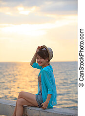 portrait of beautiful and happy emotion teenager wearing...