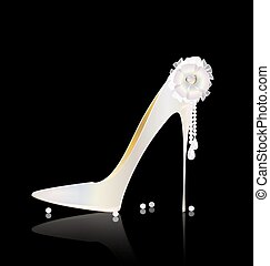 white shoe and bow - dark background and the white ladys...