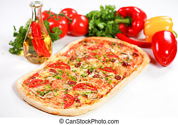 pizza with vegetables and an olive oil