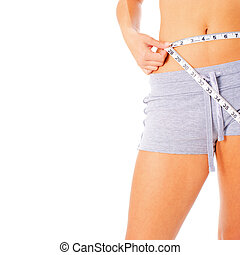Young Woman Measuring Herself - Young woman measuring...