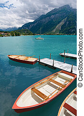 Rowboats on Lake Brienz, Berne Canton, Switzerland -...