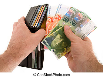 Paying Cash with Swiss Francs Currency - The action of...