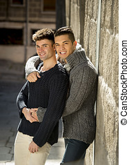 young happy gay men couple on street free homosexual love...