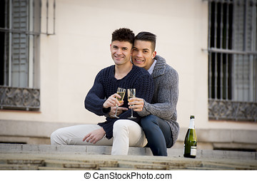 young attractive gay men couple celebrating together...