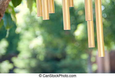 wind chimes abstract - metal wind chimes swaying in the...
