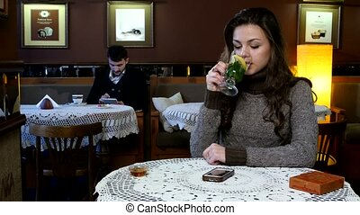 Young girl and boy drink morning tea, coffee in cafe -...
