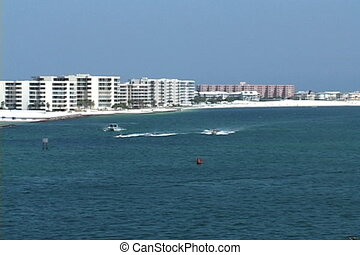 Destin Pass Condos - Motorboats speed through the Destin,...