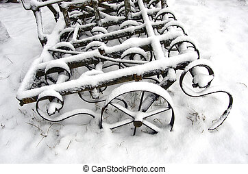 agriculture rake on snow in farm