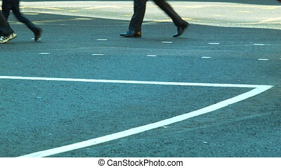 Pedestrians crossing a street - Pedestrians crossing the...