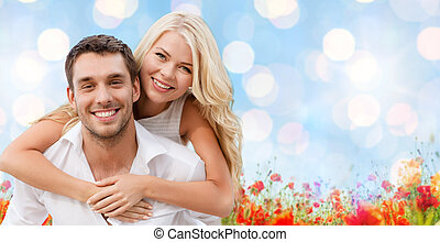 happy couple having fun over natural background - holiday,...