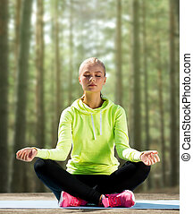 happy young woman doing yoga outdoors - sport, fitness, yoga...
