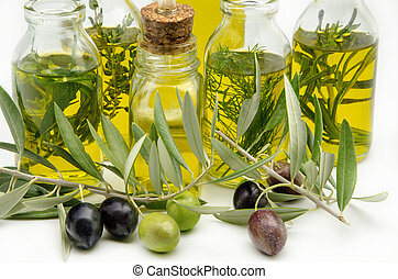 Extra virgin olive oil surrounded by freshly harvested...