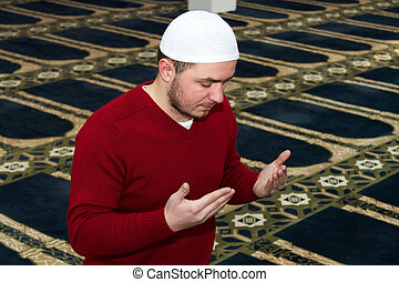 Young muslim man showing Islamic prayer - Photo of the Young...
