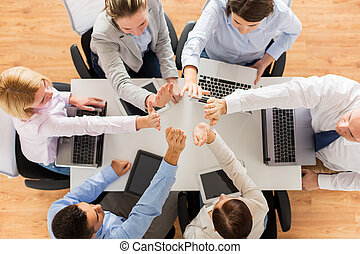 close up of business team showing high five - business,...
