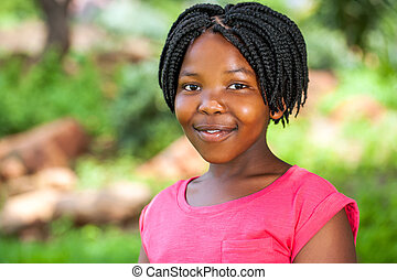 Young African girl with braids. - Close up portrait of young...