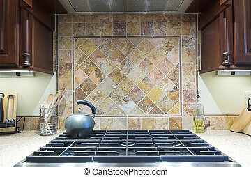 expensive stove and backsplash - expensive industrial...