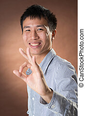 ok - Young Chinese frank businessman give you an Okay...