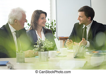 Business discussion - Three experienced employers and...