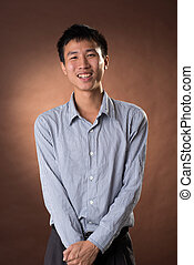 Young Chinese frank businessman, closeup portrait in studio