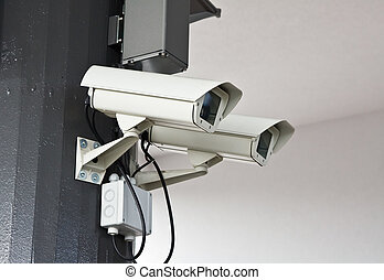 Outdoor surveillance cameras on the wall