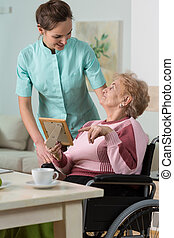 Nurse caring about handicapped woman - Image of nurse caring...