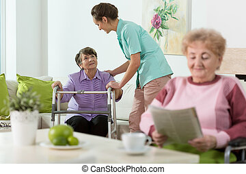Women staying in care home - Disabled senior women staying...