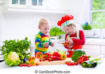 Children preparing healthy vegetable lunch - Two little...