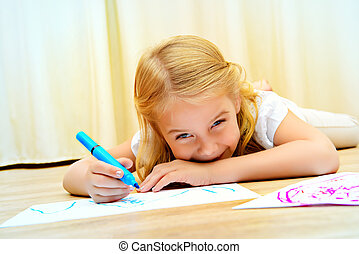 art therapy - Cute girl lying on a floor and drawing on...
