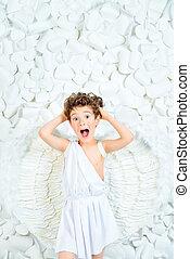 cherub - Portrait of a lovely emotional little boy in a...