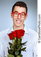 courtship - Portrait of a smiling young man in glasses...