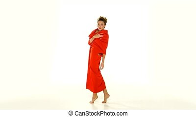 Blond woman showing the unusual red dress-changeling on...