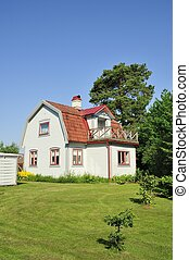Swedish housing with with beautiful garden.