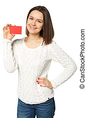 Young woman holding empty credit card, over white background...