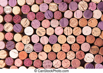 Closeup of used wine corks, some with year stamp
