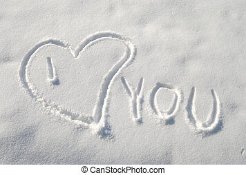 Love sign on snow in winter morning
