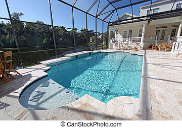 Swimming Pool - A swimming pool area at a large home
