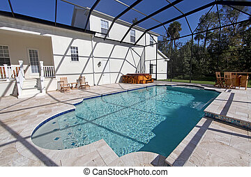 Swimming Pool - A swimming pool and hot tub at a large home