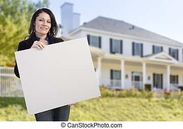 Hispanic Female Holding Blank Sign In Front of House