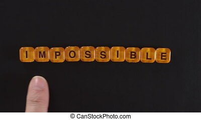 Letters Spell Impossible Possible - Close up shot of a man...